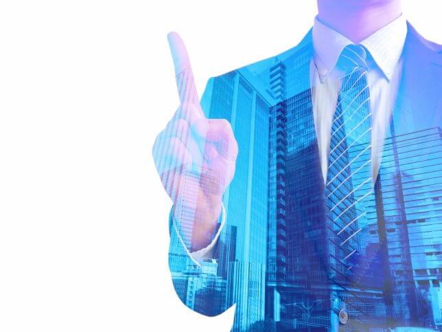 指を指すビジネスマンのイメージ