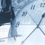 ビジネスマンと時計のイメージ